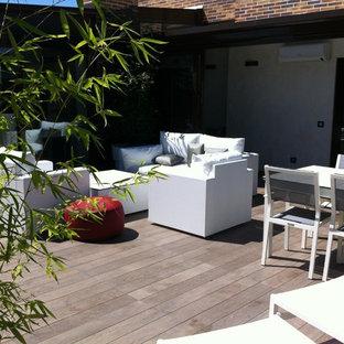 Imagen de terraza contemporánea, grande, en azotea, con jardín de macetas y toldo