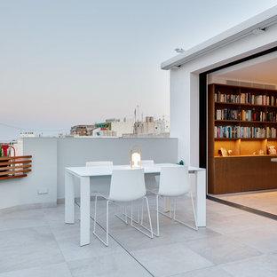Foto de terraza contemporánea, sin cubierta, en azotea, con jardín de macetas