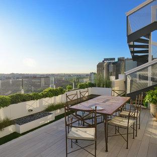 Ejemplo de terraza contemporánea, sin cubierta, en azotea, con jardín de macetas