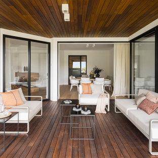Foto de terraza contemporánea en anexo de casas