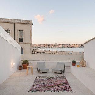 Ispirazione per una terrazza mediterranea sul tetto e sul tetto con nessuna copertura