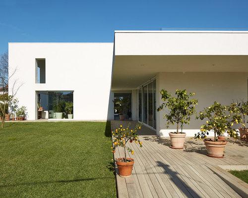 Foto e idee per patii e portici patio o portico moderno for Case con portici