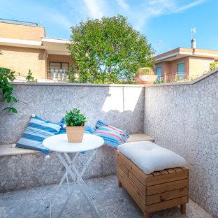 Ispirazione per una piccola terrazza stile marinaro con nessuna copertura