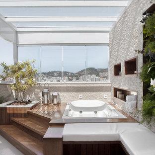 Ispirazione per una terrazza contemporanea sul tetto e sul tetto