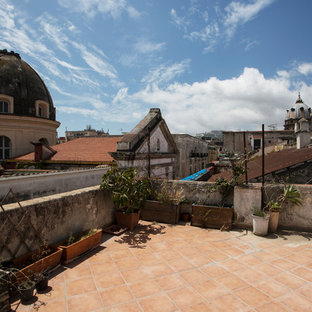 Large scandi roof terrace in Naples with a pergola.