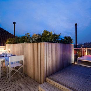 Ispirazione per grandi terrazze e balconi contemporanei sul tetto con un giardino in vaso