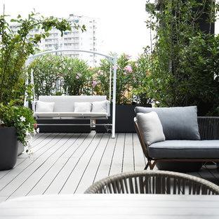Esempio di terrazze e balconi tradizionali sul tetto con un giardino in vaso e nessuna copertura