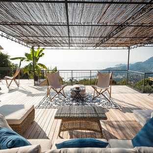 Design ideas for a large coastal back terrace and balcony in Other with a pergola.