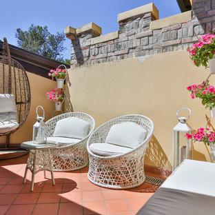 Idee per terrazze e balconi mediterranei di medie dimensioni e sul tetto con un giardino in vaso e nessuna copertura