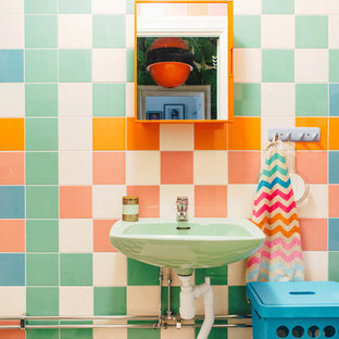 Photo of an eclectic cloakroom in Stockholm with green tiles, orange tiles, pink tiles, white tiles and multi-coloured walls.