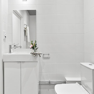 Mid-sized danish powder room photo in Stockholm with flat-panel cabinets and white cabinets