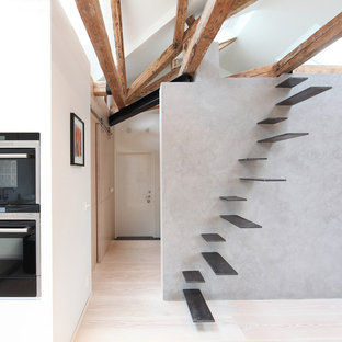 Example of a mid-sized trendy painted floating staircase design in Stockholm with painted risers