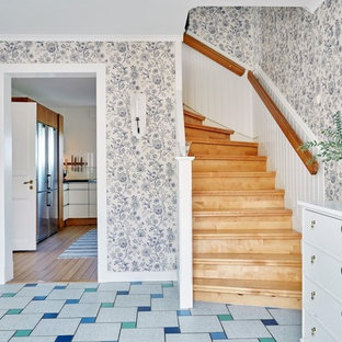Example of a mid-sized country wooden curved staircase design in Gothenburg with wooden risers
