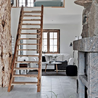 Photo of a medium sized rustic wood straight staircase in Malmo with open risers.