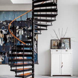 Example of a mid-sized danish painted spiral open staircase design in Stockholm