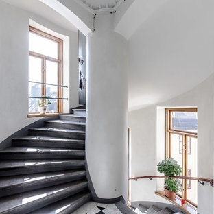 Huge transitional concrete spiral staircase photo in Stockholm with concrete risers