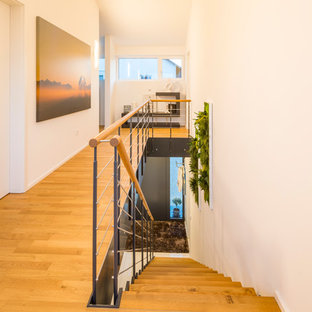 Staircase - large contemporary painted straight mixed material railing staircase idea in Munich