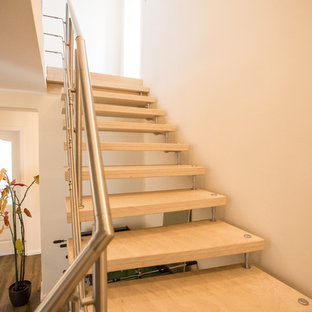 Staircase - mid-sized contemporary painted l-shaped metal railing staircase idea in Hamburg