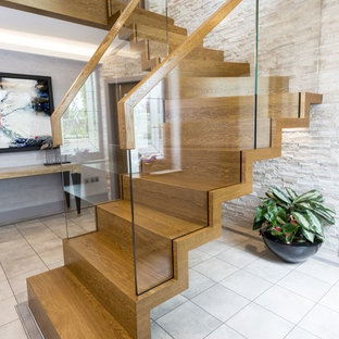 Staircase - mid-sized contemporary painted floating glass railing staircase idea in Munich with painted risers