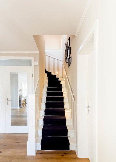 Traditional Staircase by Ferreira | Verfürth Architekten