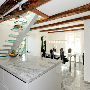 Staircase - small traditional curved metal railing staircase idea in Other with glass risers