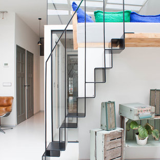 Inspiration for a small contemporary metal straight staircase in Other with metal risers.