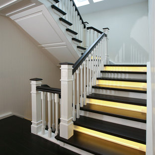 Staircase - mid-sized transitional painted u-shaped staircase idea in Bremen with painted risers