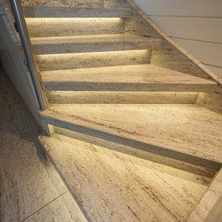 PVC, Teppich & Laminat raus. Treppenrenovierung mit Naturstein.