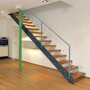 Staircase - mid-sized industrial painted straight open and mixed material railing staircase idea in Other