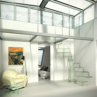 Mid-sized trendy glass curved glass railing staircase photo in Munich with glass risers