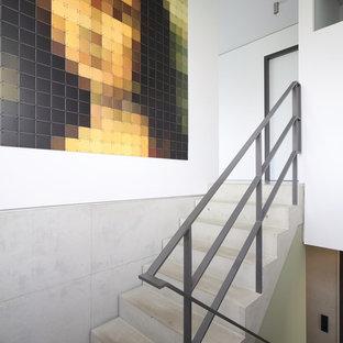 """Ispirazione per una piccola scala a """"U"""" contemporanea con pedata in cemento e alzata in cemento"""