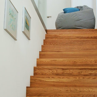 Example of a small trendy painted straight staircase design in Frankfurt with painted risers