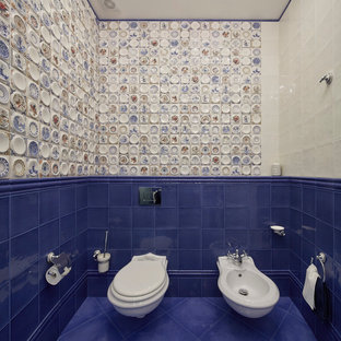 This is an example of a classic cloakroom in Moscow with a bidet, blue tiles, white tiles, multi-coloured tiles and blue floors.