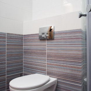Small contemporary cloakroom in Other with a wall mounted toilet, pink tiles, ceramic tiles, purple walls, ceramic flooring, purple floors, a wall-mounted sink and solid surface worktops.