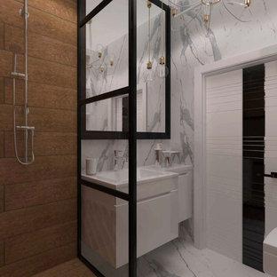 他の地域の小さいコンテンポラリースタイルのおしゃれなトイレ・洗面所 (フラットパネル扉のキャビネット、白いキャビネット、モノトーンのタイル、磁器タイル、白い壁、磁器タイルの床、壁付け型シンク、大理石の洗面台、白い床、白い洗面カウンター、フローティング洗面台、羽目板の壁、壁掛け式トイレ、折り上げ天井) の写真