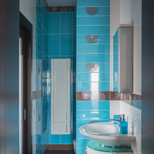 Inspiration for a small contemporary cloakroom in Moscow with flat-panel cabinets, white cabinets, a one-piece toilet, multi-coloured tiles, ceramic tiles, multi-coloured walls, ceramic flooring and a vessel sink.