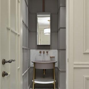 На фото: туалет в стиле современная классика с серыми стенами, консольной раковиной, белым полом, полом из керамогранита и фасадами островного типа с
