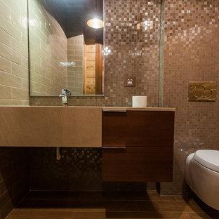 Foto di un piccolo bagno di servizio contemporaneo con ante lisce, ante in legno scuro, WC sospeso, piastrelle beige, piastrelle in ceramica, pavimento in gres porcellanato, lavabo integrato e top in pietra calcarea