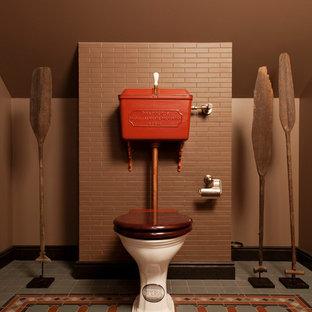На фото: туалеты в стиле фьюжн с раздельным унитазом, коричневыми стенами, разноцветным полом и коричневой плиткой