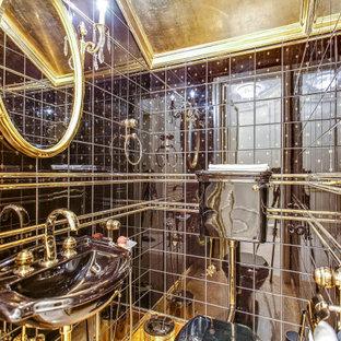 На фото: туалет в классическом стиле с коричневой плиткой с