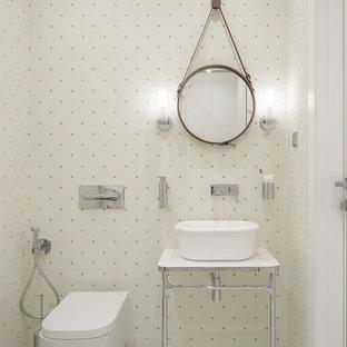 Пример оригинального дизайна: маленький туалет в современном стиле с инсталляцией, белыми стенами, белым полом, полом из мозаичной плитки и настольной раковиной