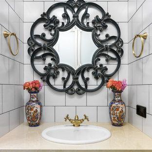 Удачное сочетание для дизайна помещения: туалет в стиле фьюжн с белой плиткой, накладной раковиной, цементной плиткой и белыми стенами - самое интересное для вас