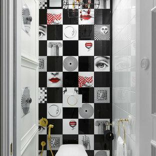 Ispirazione per un piccolo bagno di servizio bohémian con WC sospeso e pistrelle in bianco e nero