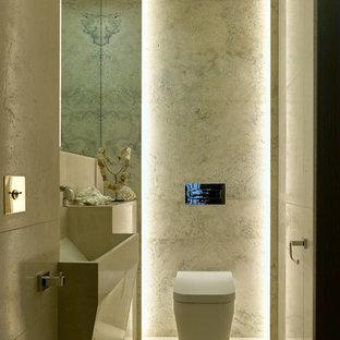 Пример оригинального дизайна: туалет в современном стиле с монолитной раковиной, унитазом-моноблоком и белым полом