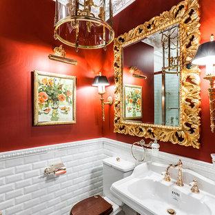 Ispirazione per un bagno di servizio chic con WC a due pezzi, piastrelle bianche, piastrelle diamantate, pareti rosse, lavabo a colonna e pavimento multicolore