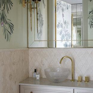 На фото: туалеты в стиле современная классика с белыми фасадами, бежевой плиткой, настольной раковиной, серой столешницей и фасадами с выступающей филенкой