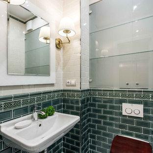 На фото: туалет в стиле неоклассика (современная классика) с стеклянными фасадами, инсталляцией, зеленой плиткой, белой плиткой, подвесной раковиной и белым полом