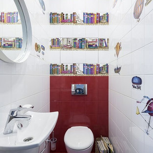 Contemporary cloakroom in Moscow with a wall mounted toilet, red tiles, white tiles, multi-coloured tiles, ceramic tiles, ceramic flooring, a wall-mounted sink and red floors.