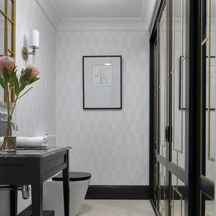 На фото: туалет среднего размера в стиле современная классика с черными фасадами, раздельным унитазом, полом из керамогранита, врезной раковиной, мраморной столешницей, бежевым полом и серой плиткой с