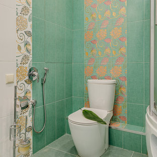Photo of a contemporary cloakroom in Moscow with a two-piece toilet, green tiles and green floors.